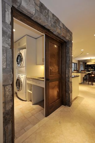 Rustic Laundry Room with Natural stone wall, Eldorado Stone Rough Cut, Sliding barn door, MS International Tuscany Ivory