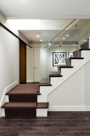 Contemporary Staircase with Crown molding, Glass staircase, Sunken living room, interior wallpaper, Louvered door