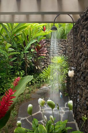 Tropical Master Bathroom with Calazzo Pavo Outdoor Shower, Exposed beam, Rain shower, Natural stone flooring