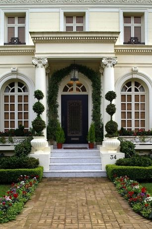 Traditional Front Door with Arched window, Arbor, Transom window, Raised beds, exterior brick floors, Pathway