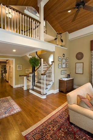 Traditional Staircase with Hardwood floors, High ceiling, Columns