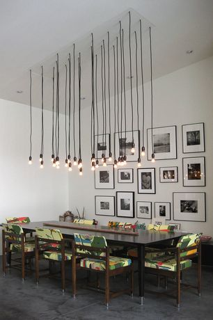 Contemporary Dining Room with Pendant light, Concrete floors, can lights, Standard height