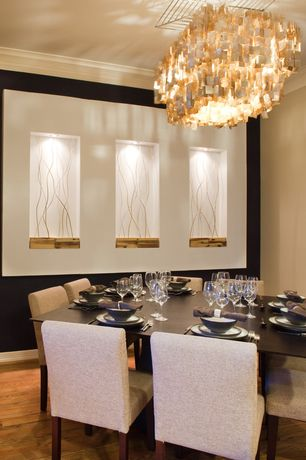 Contemporary Dining Room with Standard height, Crown molding, Chandelier, Hardwood floors