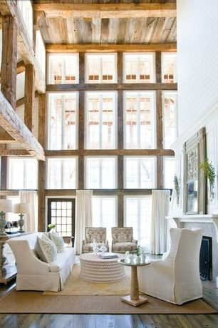Rustic Great Room with other fireplace, High ceiling, Exposed beam, French doors, Hardwood floors, Casement, Fireplace