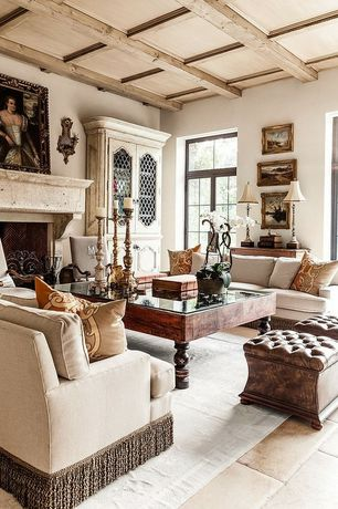 Traditional Living Room with Exposed beam, Standard height, limestone tile floors, Box ceiling, Paint, Built-in bookshelf