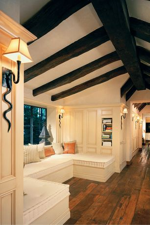 Traditional Hallway with Window seat, Decorative Pillow, Built-in bench seating, Wall sconce, Exposed beam, Cathedral ceiling