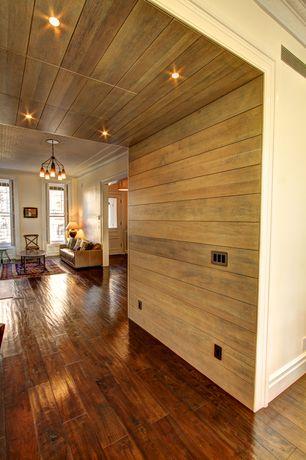 Rustic Hallway with Hardwood floors, Horizontal wood paneling, Recessed lighting, Wrought iron chandelier, Leather sofa