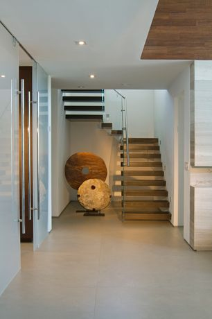 Contemporary Staircase with French doors, Floating staircase, Concrete floors