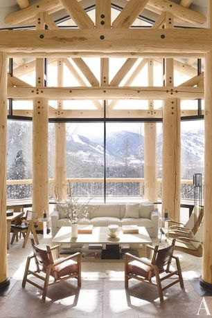 Rustic Living Room with travertine floors, Exposed beam, High ceiling, Columns, picture window