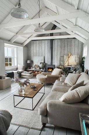 Cottage Living Room with Crate and barrel coffee table, High ceiling, Pendant light, Hardwood floors, Exposed beam