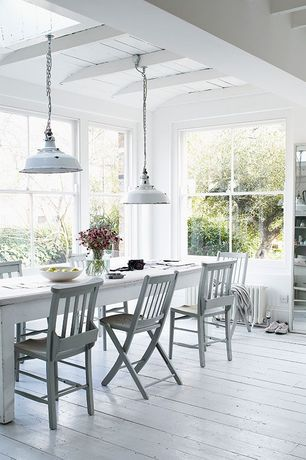 Cottage Dining Room with double-hung window, Standard height, Mismatched chairs - painted same color, Paint, Exposed beam