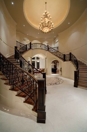 Traditional Staircase with can lights, Wainscotting, Hardwood floors, Double staircase, Cathedral ceiling, Chandelier