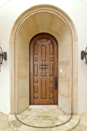 Mediterranean Front Door with exterior stone floors