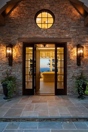 Craftsman Front Door with exterior stone floors, Restoration hardware italian fluted urn, The shade store tulip roman shade