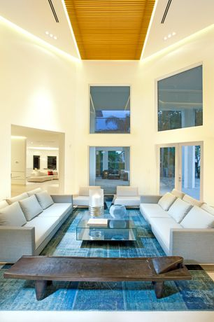 Contemporary Living Room with can lights, French doors, limestone floors, Cathedral ceiling, picture window