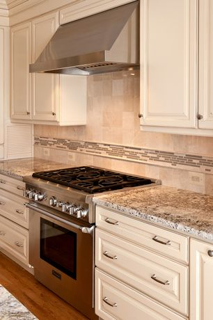 Traditional Kitchen with L-shaped, Complex granite counters, Mosaic tile classic white brown blend, Stone Tile, Glass panel