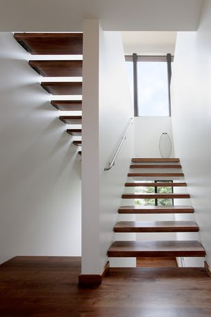 Contemporary Staircase with Floating staircase, High ceiling, Hardwood floors