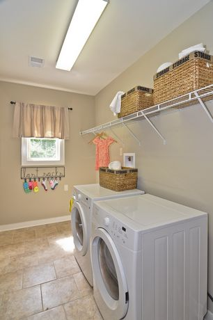 Modern Laundry Room with stone tile floors, Standard height, sandstone tile floors, Drop-in sink, Hanging Bar, Casement
