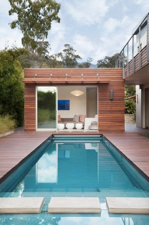 Contemporary Swimming Pool with Deck Railing, sliding glass door, Other Pool Type, Pathway
