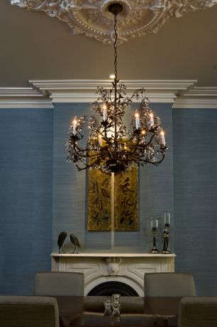 Traditional Dining Room with Standard height, Fireplace, Chandelier, Crown molding, Cement fireplace, can lights