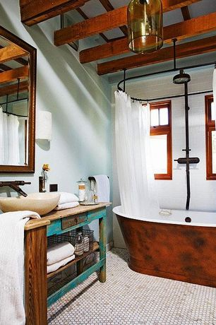 Country Full Bathroom with double-hung window, shower bath combo, Exposed beam, penny tile floors, Vessel sink, Bathtub
