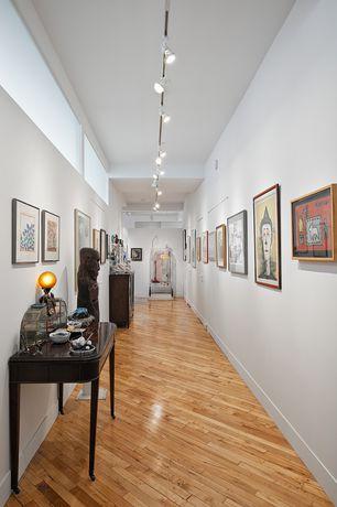 Eclectic Hallway with Hardwood floors