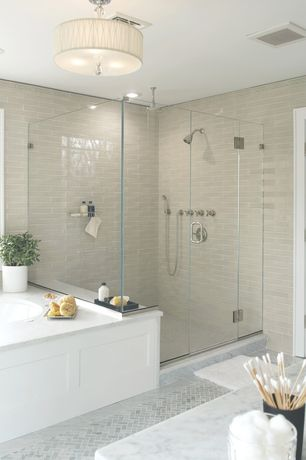 Contemporary Master Bathroom with frameless showerdoor, Ann Sacks Statuary Classic Herringbone, Complex marble counters