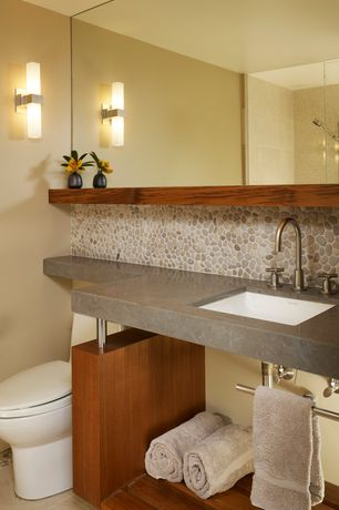Contemporary Master Bathroom with Master bathroom, Handheld showerhead, Wall sconce, Floating countertop with teak vanity