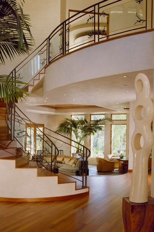 Contemporary Staircase with High ceiling, Hardwood floors, curved staircase