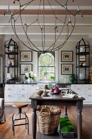 Traditional Home Office with Exposed beam, Chandelier, Glass panel door, Built-in bookshelf, Hardwood floors, Arched window