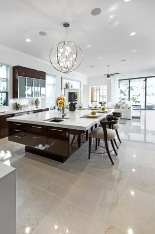 Contemporary Kitchen with Corian counters, Kitchen island, Flush, Crown molding, Chandelier, Undermount sink, L-shaped