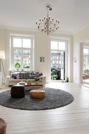 Traditional Living Room with Crown molding, Glass panel door, Tripod floor lamp, High ceiling, White washed hardwood floor