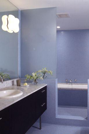 Contemporary Master Bathroom with Complex marble counters, Giorbello Cristezza Select Glass Tile in Powder Room Blue, Flush