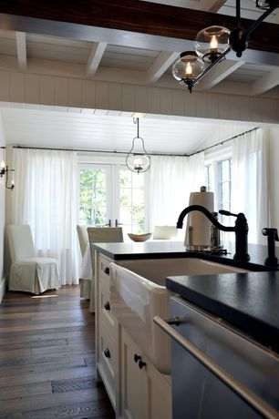 Cottage Kitchen with One-wall, Framed Partial Panel, Farmhouse sink, Flat panel cabinets, Simple granite counters, dishwasher