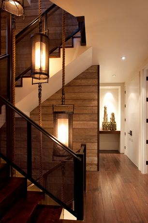Contemporary Hallway with Reclaimed wood, Hardwood floors, Blackened steel, curved staircase, Standard height, flat door