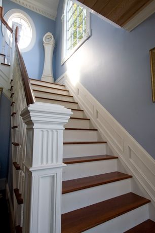 Traditional Staircase with Arched window, High ceiling, Hardwood floors, Crown molding, Wainscotting