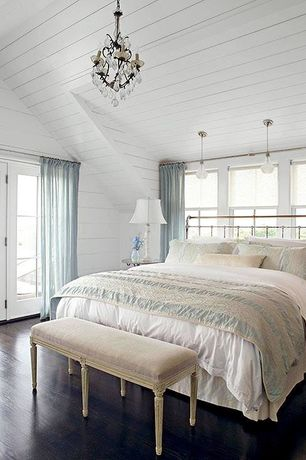 Cottage Guest Bedroom with High ceiling, Chandelier, French doors, Hardwood floors, Pendant light