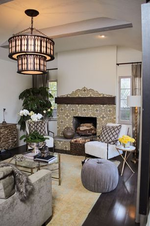 Eclectic Living Room with Chandelier, Exposed beam, stone fireplace, Hardwood floors, Lazzaro Leather Chair