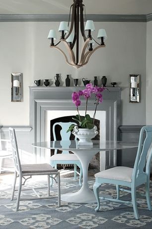 Contemporary Dining Room with Hardwood floors, Standard height, Fireplace, Wall sconce, Crown molding, Chandelier, Paint
