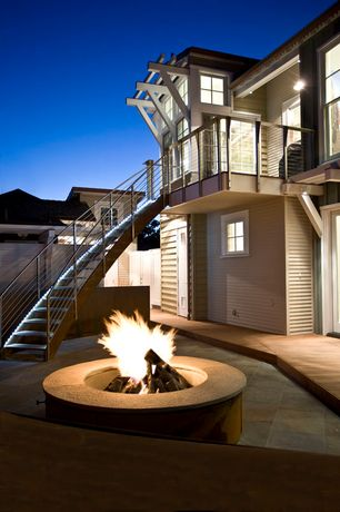 Modern Patio with exterior stone floors, Fence, Trellis, Pathway, French doors, Fire pit