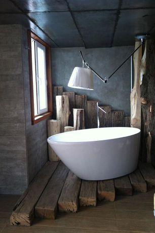 Eclectic Full Bathroom with flush light, Hardwood floors, Casement, Standard height, Bathtub, Full Bath, Freestanding