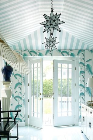 Tropical Entryway with Oversized octagonal venetian mirror, French doors, flush light, White paper parasol, Laminate floors