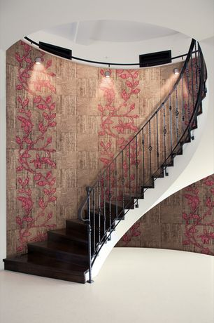 Contemporary Staircase with High ceiling, Hardwood floors, interior wallpaper, Wall sconce, curved staircase