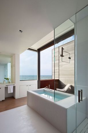 Contemporary Master Bathroom with limestone floors, frameless showerdoor, Hardwood floors, European Cabinets, Corian counters
