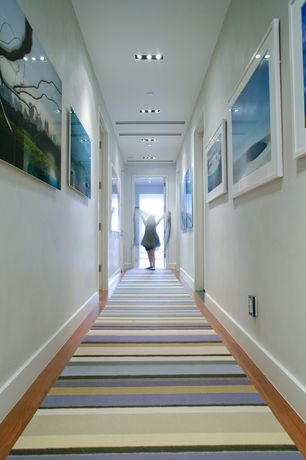 Modern Hallway with Standard height, Hardwood floors, can lights