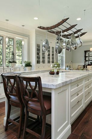 Traditional Kitchen with double-hung window, Pot rack, Pendant light, Paint 2, Wainscotting, Casement, can lights, Paint 1