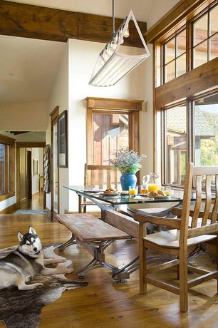 Country Dining Room with Standard height, Pendant light, Hardwood floors, Casement