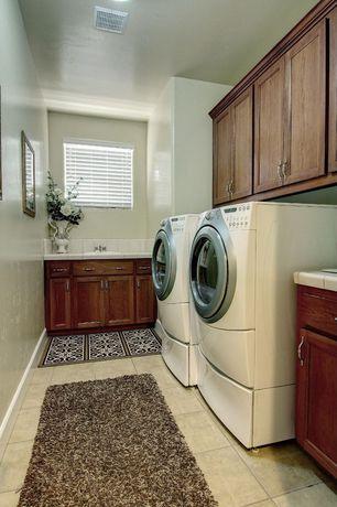 Traditional Laundry Room with Built-in bookshelf, limestone tile floors, Ann sacks davenport square field in white gloss