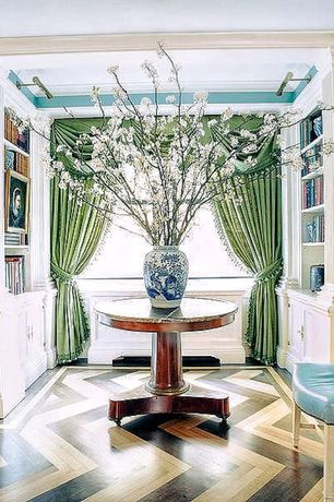 Eclectic Hallway with Built-in bookshelf, bedroom reading light, Hardwood floors, Crown molding, Paint 1, Standard height