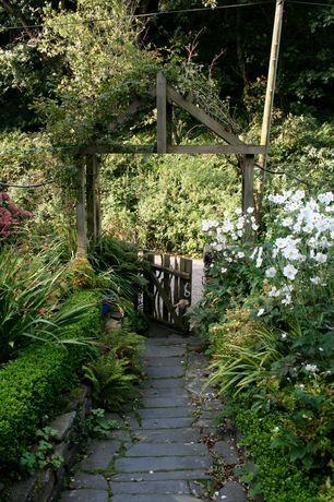 Traditional Landscape/Yard with Fence, Gate, Belgard arbel pavers mega-arbel, Reclaimed wood, Raised beds, Arbor